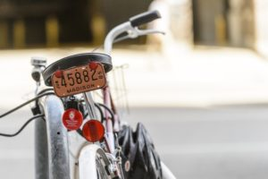 A bicycle with a novelty Madison license plate sits outside of the McBurney Disability Resource Center at the University of Wisconsin-Madison on Sept. 19, 2014. (Photo by Bryce Richter / UW-Madison)