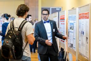 Faisal Bin Salem (right) presents his research project to attendees at the Undergraduate Research Symposium hosted in Varsity Hall at Union South at the University of Wisconsin-Madison on April 14, 2016. The annual event showcases student-led research, creative endeavors and service-learning projects. (Photo by Bryce Richter / UW-Madison)