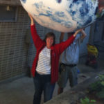 Laura Shere holding a giant inflated globe