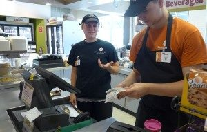 Student cashiers at Ingraham deli sort a stack of unwanted receipts.