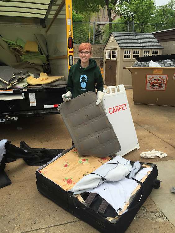 Maddy Sicora deconstructed a futon while volunteering at Sustainability Move Out