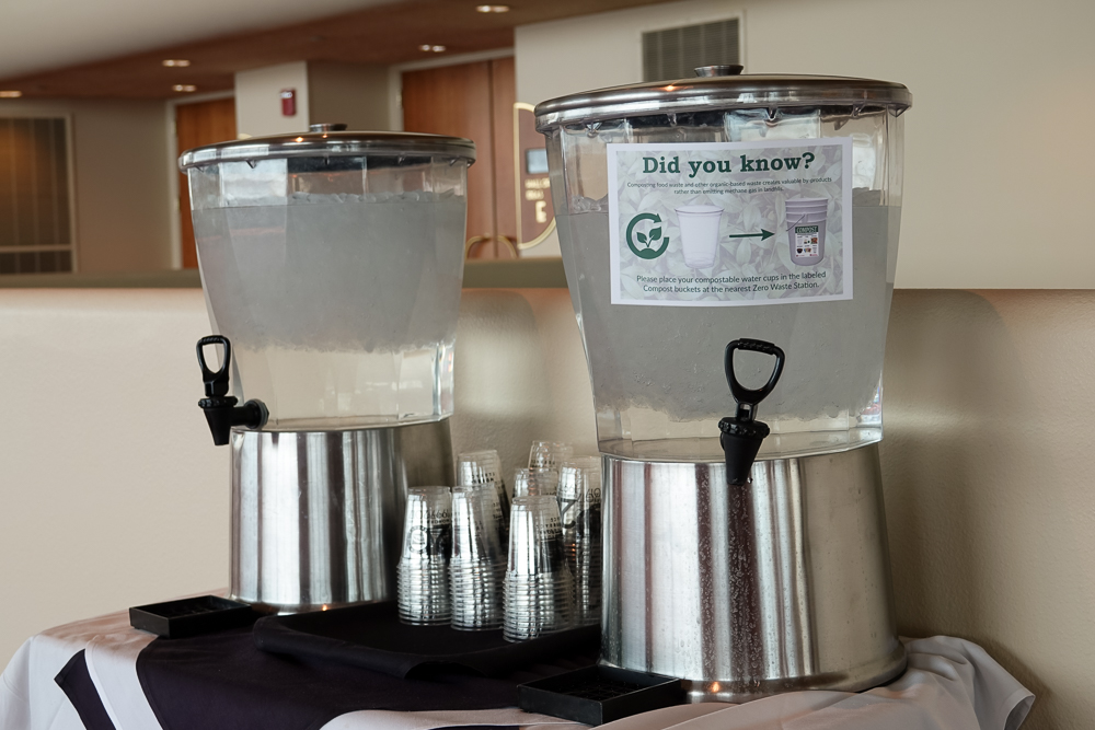 Water station with zero waste signage.
