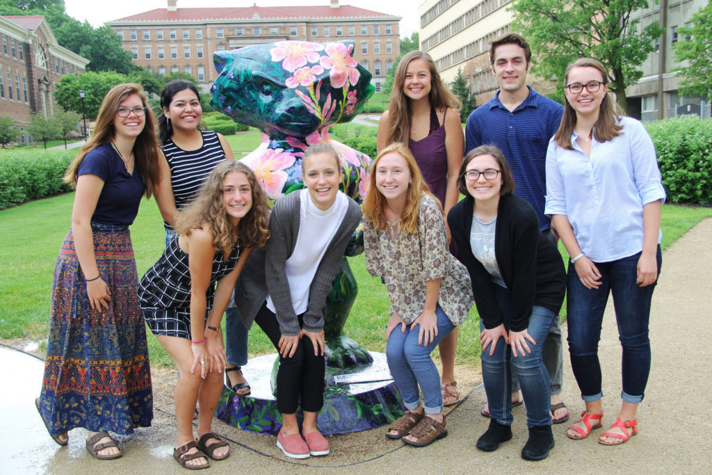 The new group of interns pose with Bucky on Henry Mall.