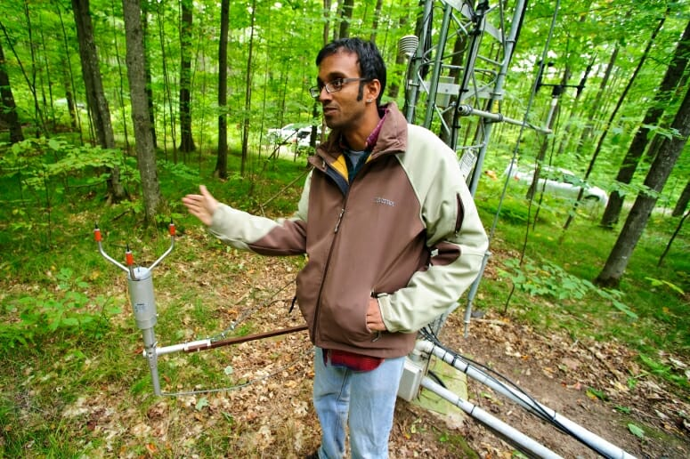 Ankur Desai stands in front of a 27-meter-tall flux tower in 2011. PHOTO: BRYCE RICHTER