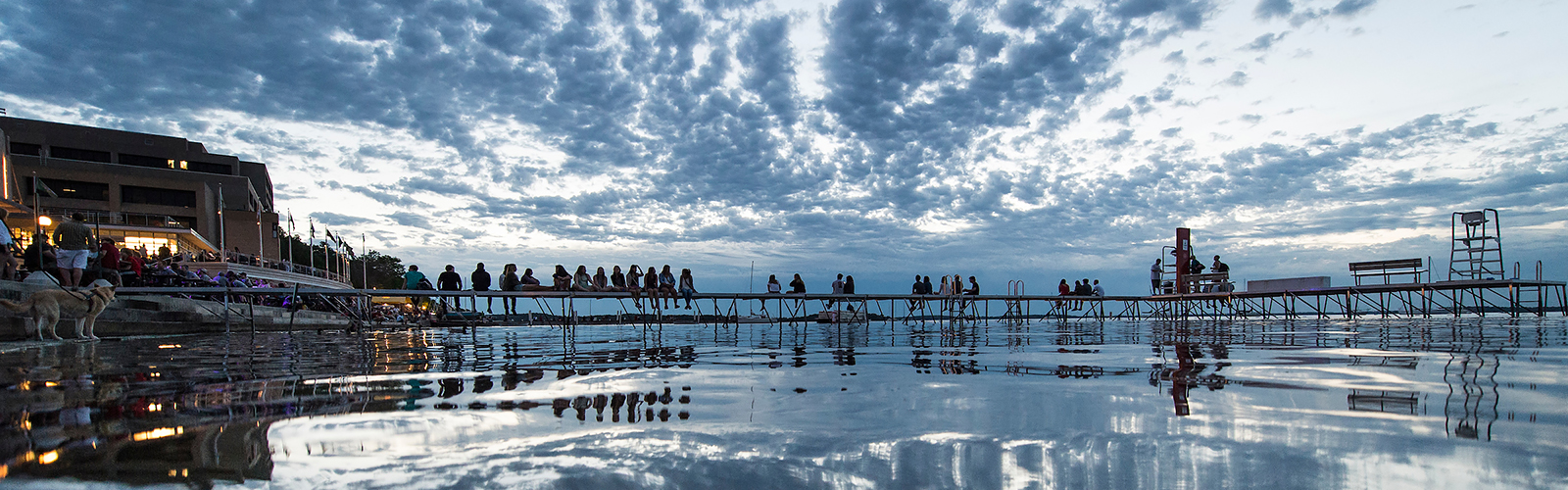 People line the Memorial Union Terrace and shoreline piers at the University of Wisconsin-Madison and take in the post-sunset view of Lake Mendota as the sky falls from dusk to nighttime during a summer evening on June 14, 2014. (Photo by Jeff Miller/UW-Madison)