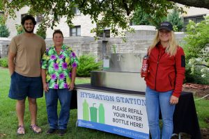 Sam Grindel, Marcella Otter (Physical Plant), and Breana Nehls pose by one of the new hydration stations.