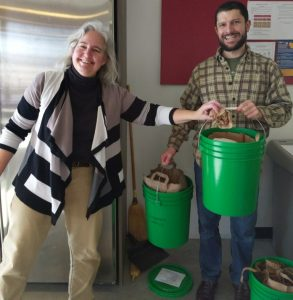 Lakeshore Nature Preserve's Rhonda James (left) and Adam Gundlach (right) helping with compost.