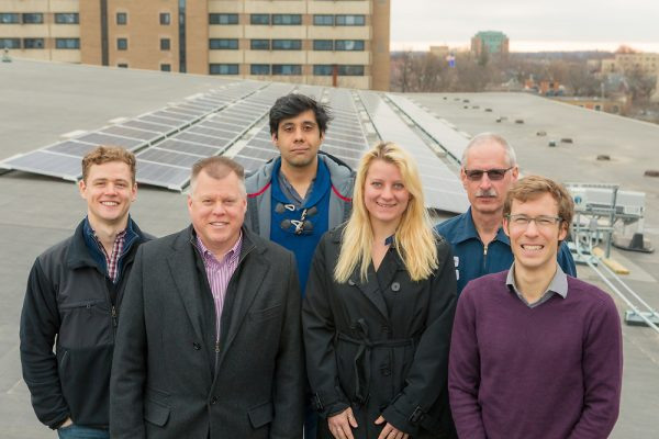 Members of Helios, Housing, Facilities Planning & Management, and the Office of Sustainability gather on the roof of Gordon Dining & Event Center. Left to right: Zach Galvin, David Darling, Sahil Verma, Breana Nehls, Stu Larose, Ian Aley.
