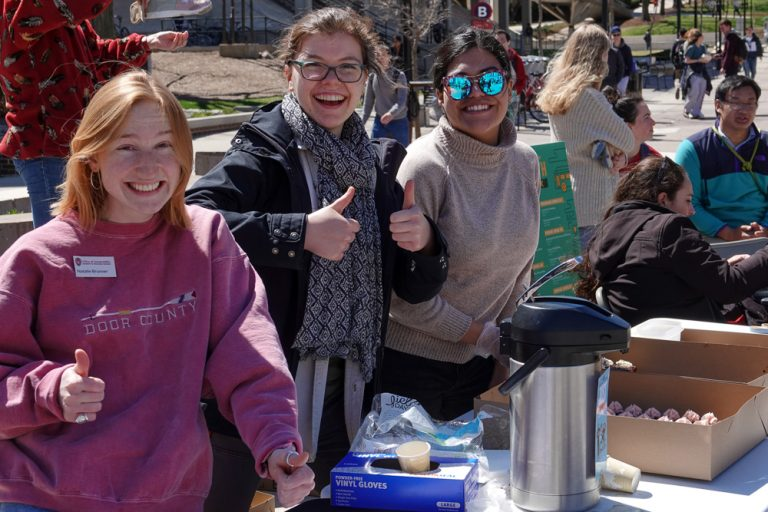 Office of Sustainability interns having fun and serving treats from Bloom Bake Shop during Fix-It Friday.