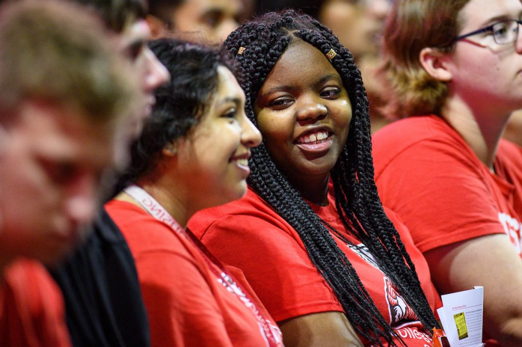 Students talk during the Chancellor's Convocation for New Students, a Wisconsin Welcome event held at the Kohl Center at the University of Wisconsin-Madison on Sept. 3, 2019. (Photo by Bryce Richter /UW-Madison)