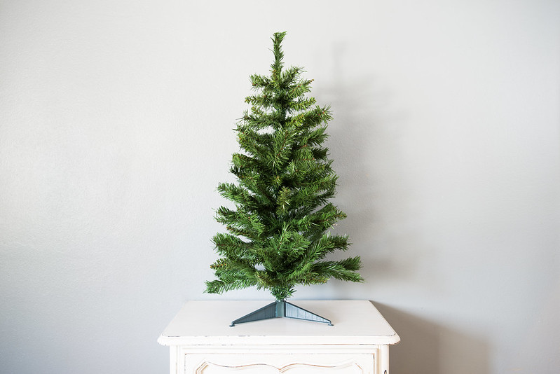 """Small artificial Christmas tree"" by Flickr user Your Best Digs."