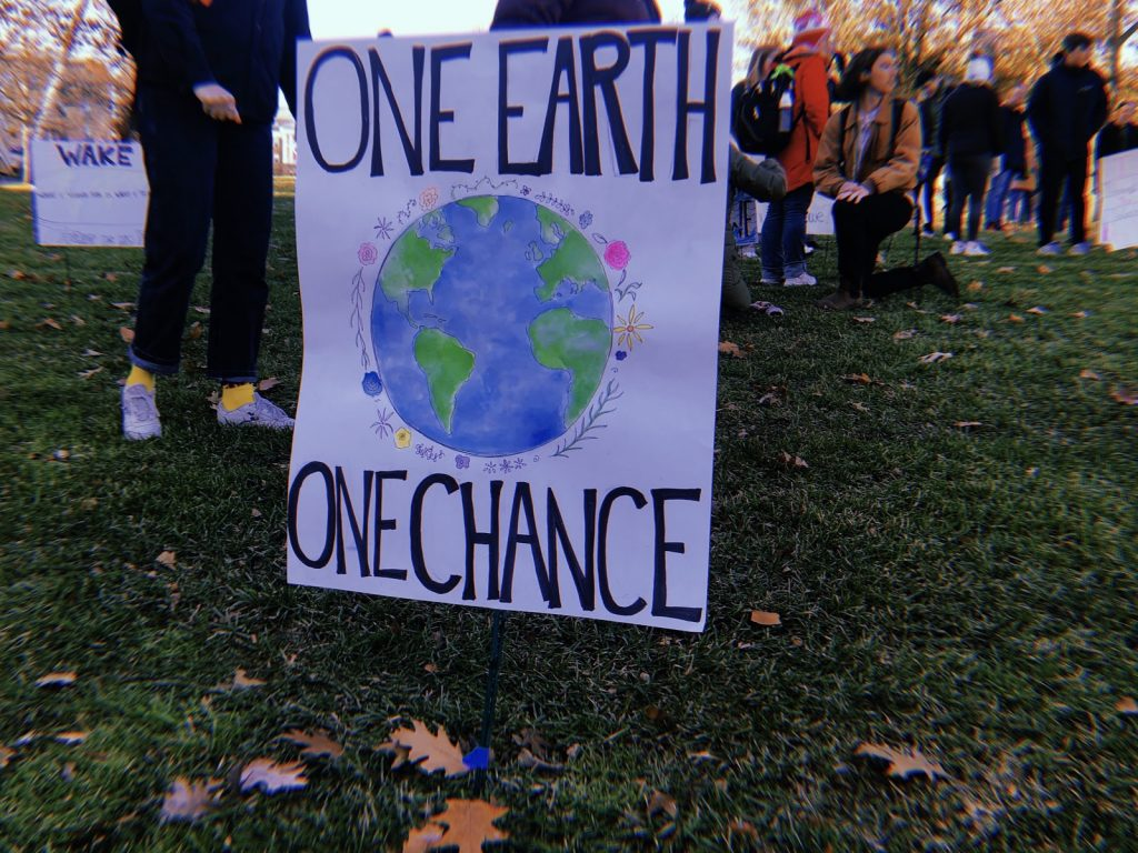 A student poster on Bascom Hill during the climate strike on Dec. 6, 2019. Photo by Norma Behrend-Martinez.