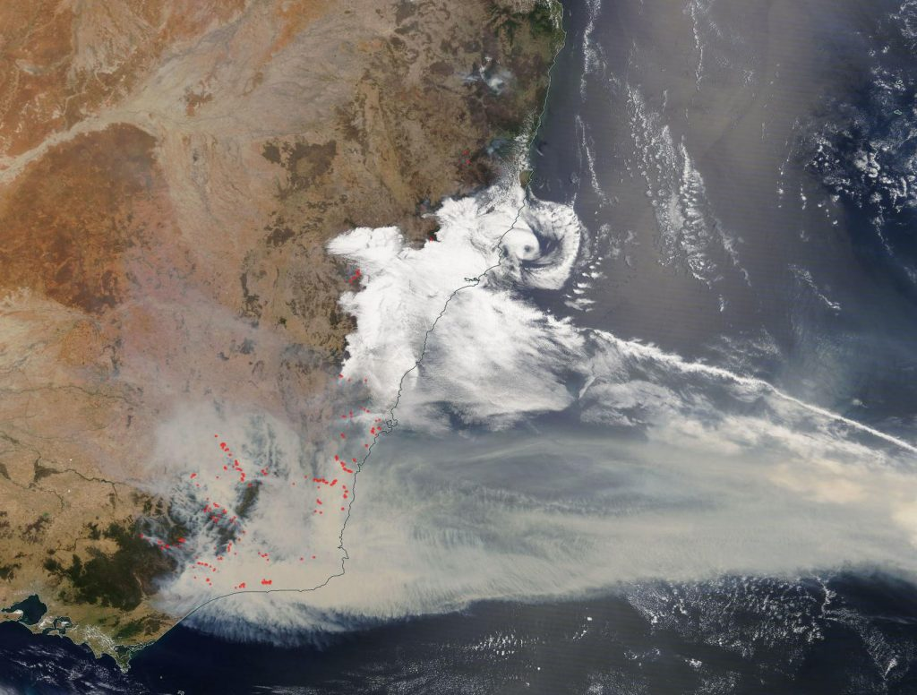 Snapshot of southeastern Australia from January 2, 2020 showing identified fires (red dots) and smoke streaming out to sea. Imagery from the NASA Worldview application (https://worldview.earthdata.nasa.gov), part of the NASA Earth Observing System Data and Information System (EOSDIS).