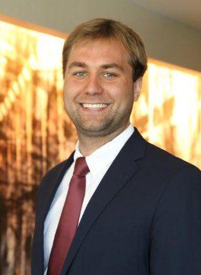 Travis Blomberg headshot