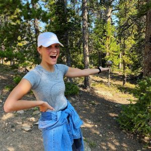 Leah Johnson gesturing in the woods