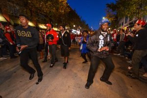 Members of the several fraternities, including Alpha Phi Alpha and Phi Beta Sigma, step dance as they make their way down State Street during the University of Wisconsin-Madison's Homecoming Parade on Oct. 16, 2015. The annual parade is one of many Homecoming week activities sponsored by the Wisconsin Alumni Association (WAA).