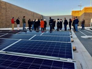 UW–Madison students and staff learning about the largest rooftop solar array in Wisconsin at Madison College.