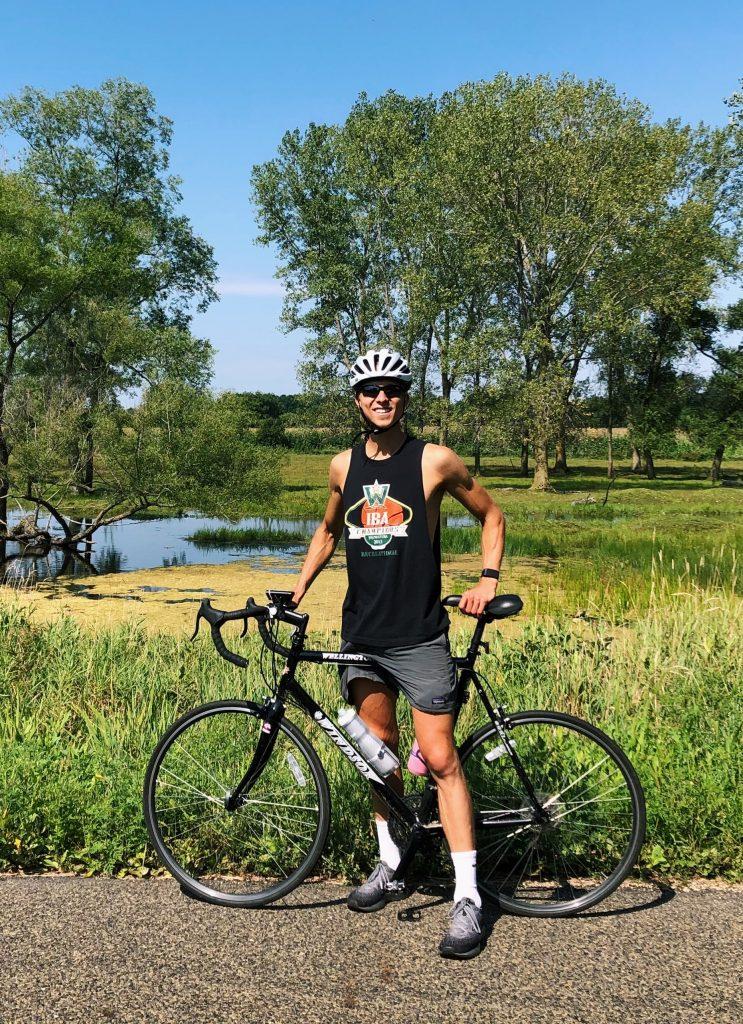 Former intern Nolan Billstrom on a bike