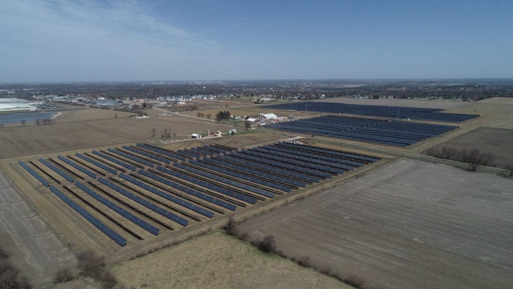 Aerial image of solar panels in a field.